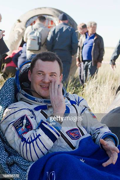Russian cosmonaut Roman Romanenko rests shortly after the landing aboard the Russian Soyuz space capsule some 150 km southeast of the town of...