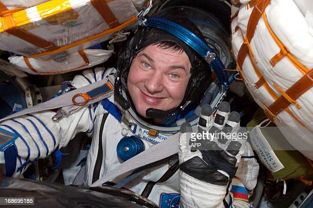 Russian cosmonaut Roman Romanenko waves from the Russian Soyuz space capsule shortly after its landing some 150 km southeast of the town of...