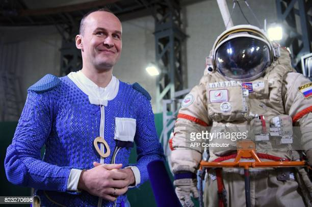 Russian cosmonaut Segei Ryazansky stands next to his space suit during a session at the Star City space training center outside Moscow on May 29 2017...