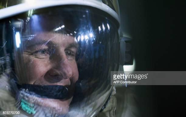 Russian cosmonaut Segei Ryazansky wearing his space suit during a session at the Star City space training center outside Moscow on May 29 2017 / AFP...