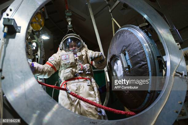 Russian cosmonaut Segei Ryazansky wears his space suit during a session at the Star City space training center outside Moscow on May 29 2017 / AFP...