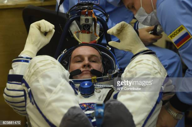 Russian cosmonaut Sergei Ryazansky a member of the main crew of the 52/53 expedition to the International Space Station reacts as his spacesuit is...