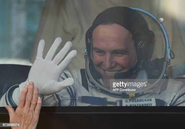 Russian cosmonaut Sergei Ryazansky a member of the main crew of the 52/53 expedition to the International Space Station gestures as he travels with...