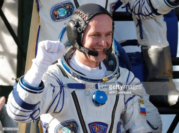 Russian cosmonaut Sergey Ryazanskiy a member of the main crew of the 51/52 expedition to the International Space Station gestures as he poses on the...