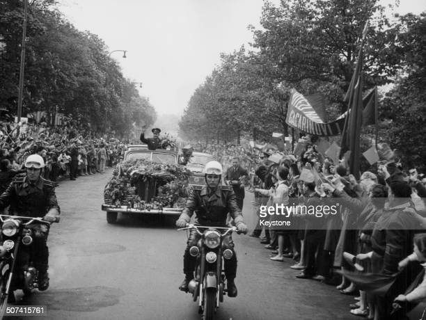 Russian cosmonaut Yuri Gagarin greeted by crowds of people as he is escorted by motorcade on an official visit to Prague Czech Republic May 1st 1961