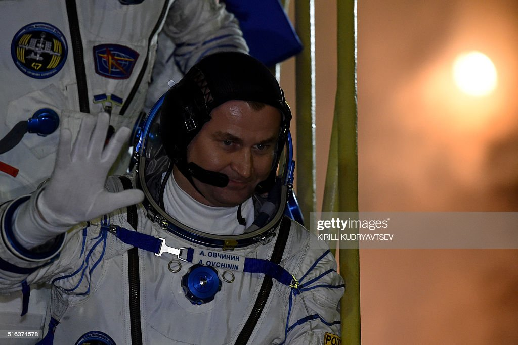 Russian cosmonauts Alexey Ovchinin waves as he boards the ...