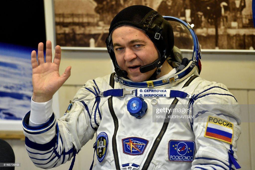 Russian cosmonauts Oleg Skripochka salutes as his space ...
