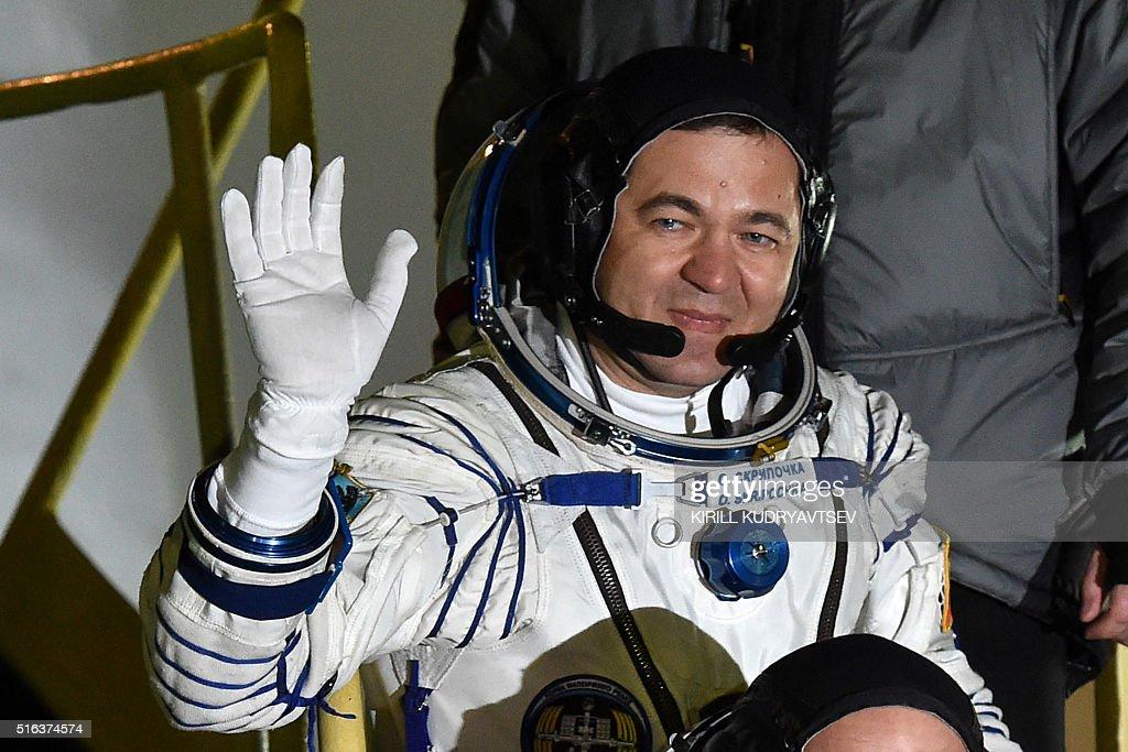 Russian cosmonauts Oleg Skripochka waves as he boards the ...
