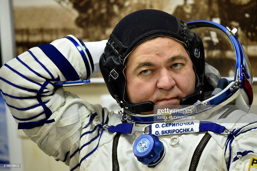 Russian cosmonauts Oleg Skripochka wears his space suit as ...