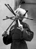 A Russian Cossack demonstrates his ablilty as a sword swallower New York May 24 1926 He is one of a troop of Russian Cossacks who will tour America...