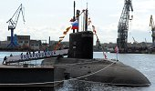 Russian crew members get on board of the newly built 'Novorossiysk' B261 multipurpose dieselelectric submarine in Saint Petersburg on August 22 2014...