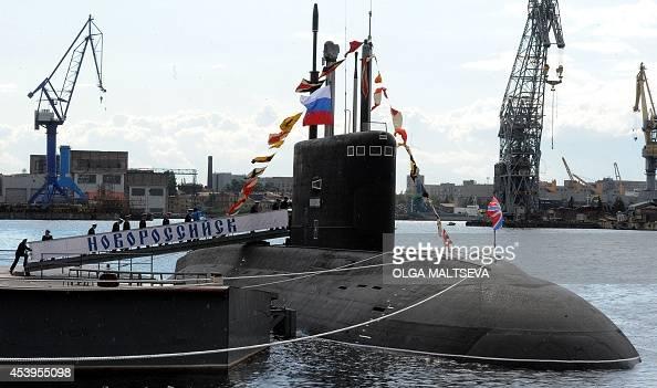 Russian crew members get on board of the newly built 'Novorossiysk' B261 multipurpose dieselelectric submarine in Saint Petersburg on August 22 2014...
