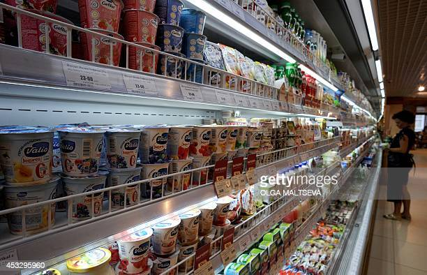 A Russian customer shops for dairy products at a supermarket in Saint Petersburg on August 7 2014 Russia retaliated against tough new Western...