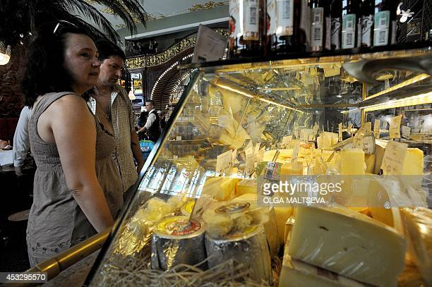 Russian customers buy cheese in Saint Petersburg on August 7 2014 Russia retaliated against tough new Western sanctions banning most food imports...