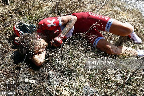 Russian cyclist Ilnur Zakarin of Katusha crashes during the Colle dell'Agnello downhill as part of the 19th stage of the 99th Giro d'Italia Tour of...