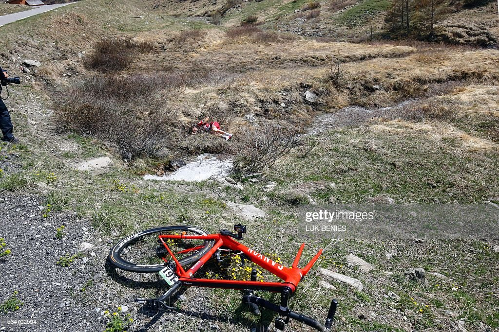 Russian cyclist Ilnur Zakarin of Katusha crashes during the Colle dell'Agnello downhill as part of the 19th stage of the 99th Giro d'Italia, Tour of Italy, from Pinerolo to Risoul on May 27, 2016. Italy's Vincenzo Nibali of Astana escaped alone to a summit-finish victory today whilst Colombia's Esteban Chaves rode into the pink jersey by coming third on the day. Pre-race favourite Italy's Vincenzo Nibali had been thought to be dead and buried on this Giro after dropping to fifth, but is now just 44seconds off new leader Chavez, in second place, ahead of another mountain stage on Saturday. BENIES