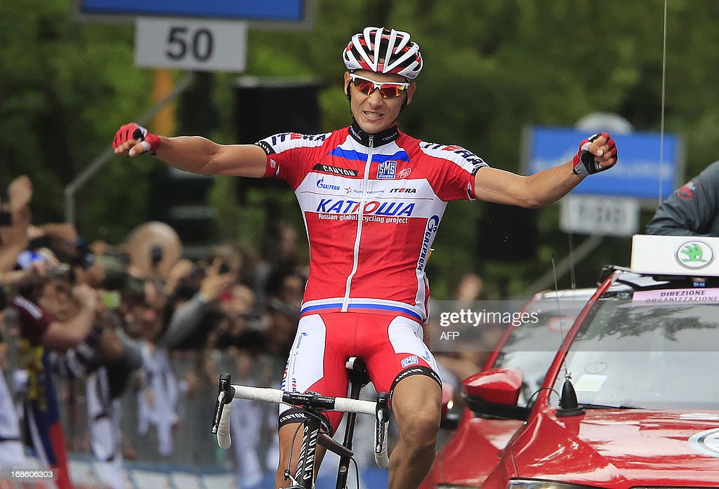 Russian cyclist Maxime Belkov celebrates as crosses the finish line and wins the 170 km 9th stage of 96th Giro d'Italia from Sansepolcro to Florence on May 12, 2013, in Florence. AFP PHOTO / LUK BENIES