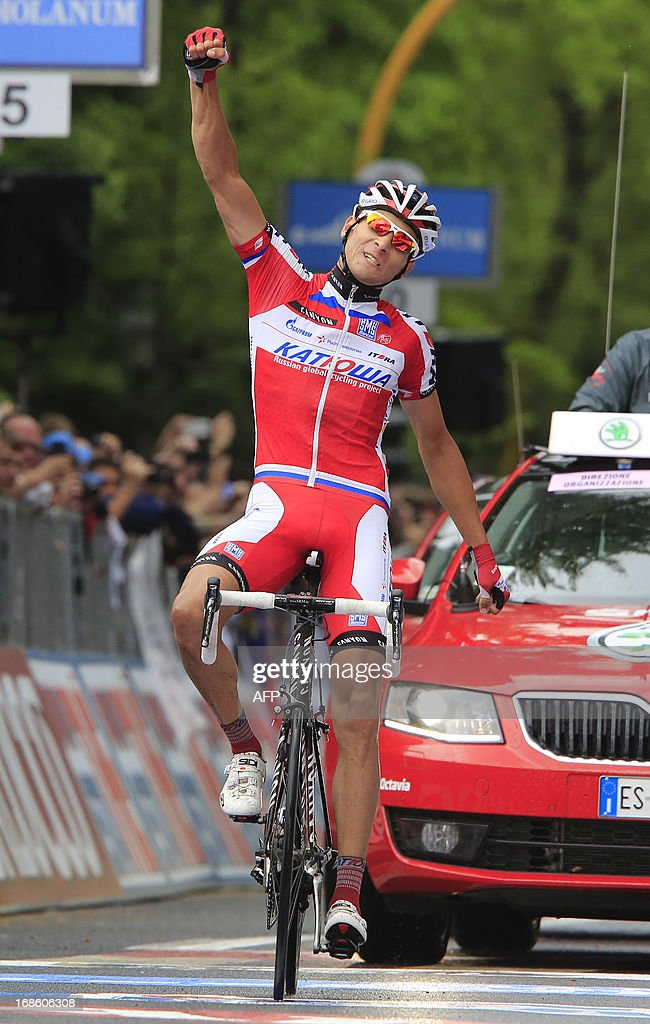 Russian cyclist Maxime Belkov celebrates as crosses the finish line and wins the 170 km 9th stage of 96th Giro d'Italia from Sansepolcro to Florence on May 12, 2013, in Florence.