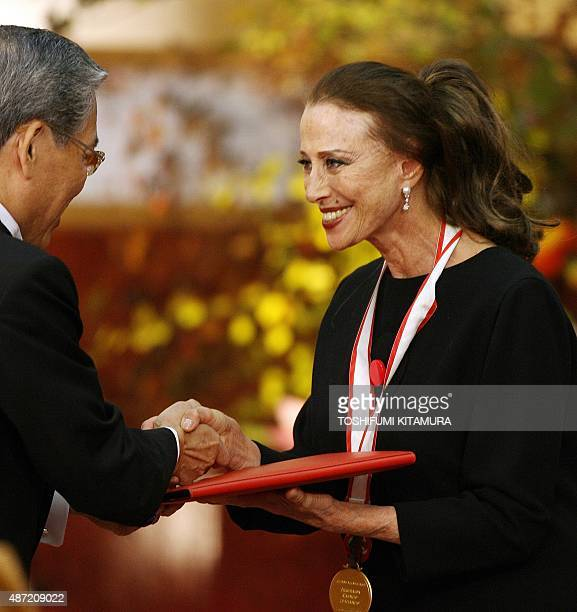 Russian dancer Maya Plisetskaya receives the winning certificate and prize money in the Theatre/film section from Hisashi Hieda a Vice Chairman of...