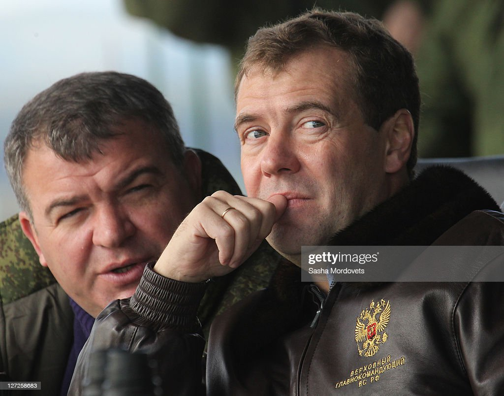 Russian Defence Minister <a gi-track='captionPersonalityLinkClicked' href=/galleries/search?phrase=Anatoly+Serdyukov&family=editorial&specificpeople=4162784 ng-click='$event.stopPropagation()'>Anatoly Serdyukov</a> (L) and Russian President <a gi-track='captionPersonalityLinkClicked' href=/galleries/search?phrase=Dmitry+Medvedev&family=editorial&specificpeople=554704 ng-click='$event.stopPropagation()'>Dmitry Medvedev</a> watch the Center-2011 military exercises September 27, 2011 in Chebarkul, Chelyabinks region, Russia. According to reports September 27, 2011, Medvedev said that if anyone in government questioned his plan to boost defense spending must work elsewhere. The Russian President fired the Finance Minister Alexei Kudrin September 26, after criticizing his military budget publicly.
