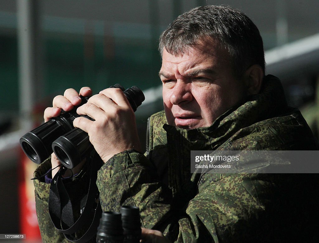 Russian Defence Minister <a gi-track='captionPersonalityLinkClicked' href=/galleries/search?phrase=Anatoly+Serdyukov&family=editorial&specificpeople=4162784 ng-click='$event.stopPropagation()'>Anatoly Serdyukov</a> watches the Center-2011 military exercises September 27, 2011 in Chebarkul, Chelyabinks region, Russia. According to reports September 27, 2011, Medvedev said that if anyone in government questioned his plan to boost defense spending must work elsewhere. The Russian President fired the Finance Minister Alexei Kudrin September 26, after criticizing his military budget publicly.