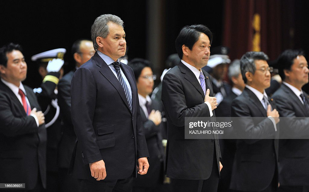 Russian Defence Minister Sergei Shoigu (2nd L) and his Japanese counterpart Itsunori Onodera (3rd R) listen to the national anthem during an welcoming ceremony at the Defense Ministry in Tokyo on November 1, 2013. Tokyo will play host to the foreign and defence ministers of Russia for a two-day visit from November 1, in the latest stage of a burgeoning relationship that represents a rare neighbourly entente for Japan. AFP PHOTO / KAZUHIRO NOGI