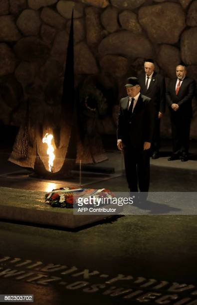 Russian DefenCe Minister Sergei Shoigu lays a wreath at the Hall of Remembrance on October 17 2017 during his visit to the Yad Vashem Holocaust...