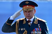 Russian Defence Minister Sergei Shoigu salutes as he takes part in a rehearsal for the Victory Day military parade on Moscow's Red Square on May 7...