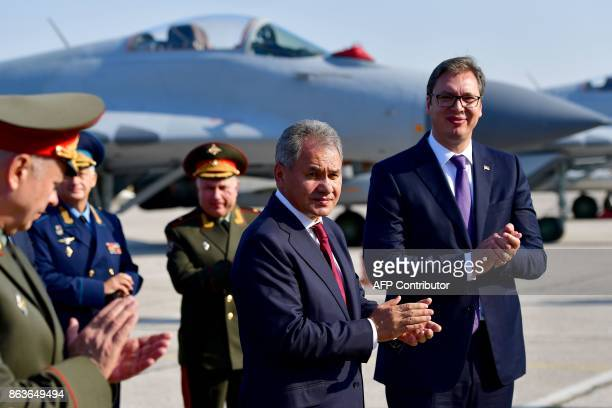 Russian Defense Minister Army General Sergei Shoigu and Serbian President Aleksandar Vucic attend a ceremony at Batajnica military airport near...