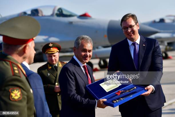 Russian Defense Minister Army General Sergei Shoigu and Serbian President Aleksandar Vucic pose for a picture during a ceremony at Batajnica military...