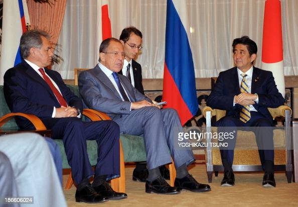 Russian Defense Minister Sergei Shoigu Russian Foreign Minister Sergey Lavrov and Japanese Prime Minister Shinzo Abe attend a meeting at the prime...