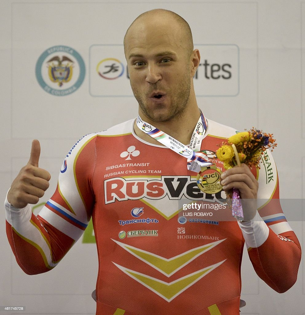 Russian <a gi-track='captionPersonalityLinkClicked' href=/galleries/search?phrase=Denis+Dmitriev&family=editorial&specificpeople=5492378 ng-click='$event.stopPropagation()'>Denis Dmitriev</a> celebrates with the gold medal after winning in UCI Cycling World Cup Men's Sprint Final, at Alcides Nieto Patino velodrome, on January 18, 2015, in Cali, Valle del Cauca department, Colombia. Russian <a gi-track='captionPersonalityLinkClicked' href=/galleries/search?phrase=Denis+Dmitriev&family=editorial&specificpeople=5492378 ng-click='$event.stopPropagation()'>Denis Dmitriev</a> won the gold medal, Jeffrey Hoogland of the Netherlands won the silver medal and Fabian Puerta of Colombia won the bronze medal in the event.