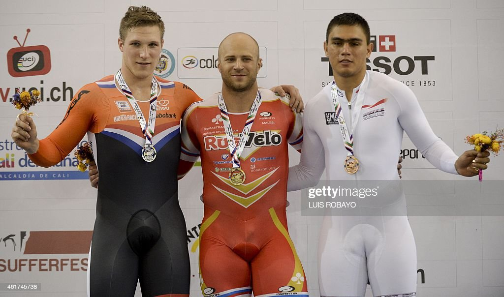 Russian <a gi-track='captionPersonalityLinkClicked' href=/galleries/search?phrase=Denis+Dmitriev&family=editorial&specificpeople=5492378 ng-click='$event.stopPropagation()'>Denis Dmitriev</a> (C) won the gold medal, Jeffrey Hoogland (L) of the Netherlands won the silver medal and Fabian Puerta of Colombia won the bronze medal pose on the winner's podium of the UCI Cycling World Cup Men's Sprint Final, at Alcides Nieto Patino velodrome, on January 18, 2015, in Cali, Valle del Cauca department, Colombia.