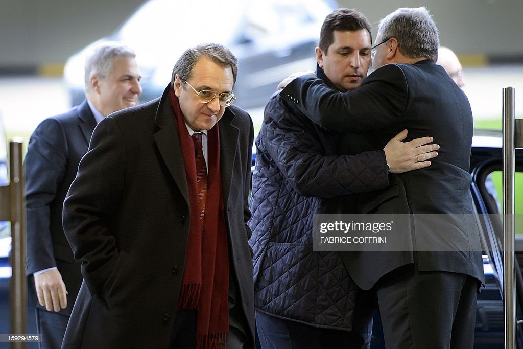 Russian Deputy Foreign Minister Mikhail Bogdanov (2nd L) arrives on January 11, 2013 for a meeting at the United Nations office in Geneva. UN peace envoy Lakhdar Brahimi is to meet with Russian Deputy Foreign Minister Mikhail Bogdanov and US Undersecretary of State William Burns for discuss ways of ending the 21-month conflict in Syria. AFP PHOTO / FABRICE COFFRINI