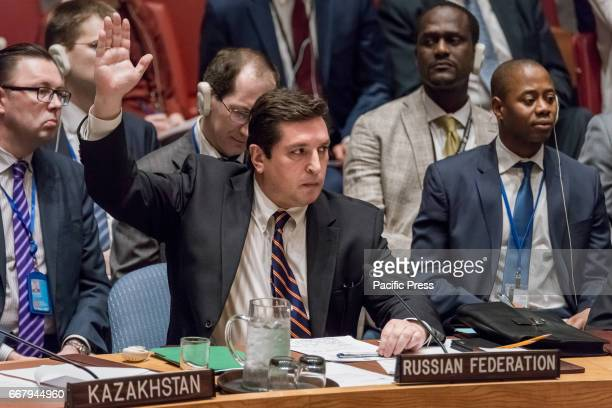 Russian Deputy Permanent Representative for Political Affairs Vladimir Safronkov is seen raising his hand in opposition to the draft resolution...