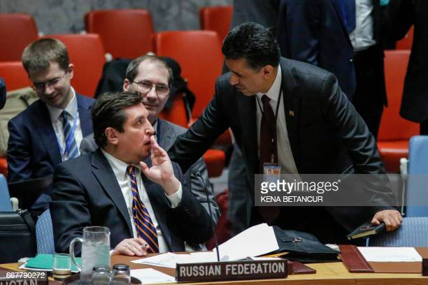 Russian Deputy Permanent Representative to the United Nations Vladimir Safronkov speaks with Bolivia's ambassador to the UN Sacha Llorentis before a...