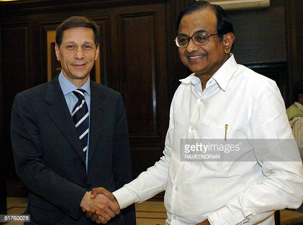 Russian Deputy Prime Minister Alexander D Zhukov shake hands with Indian Finance Minister P Chidambaram during a meeting at Ministry of Finance in...
