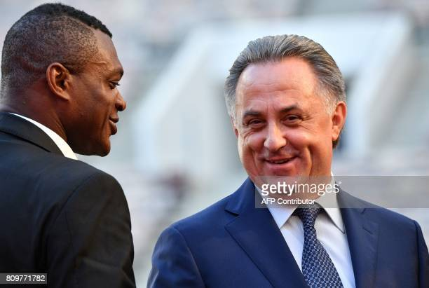 Russian Deputy Prime Minister and LOC chairman Vitaly Mutko talks with former French National football player Marcel Desailly during the FIFA World...