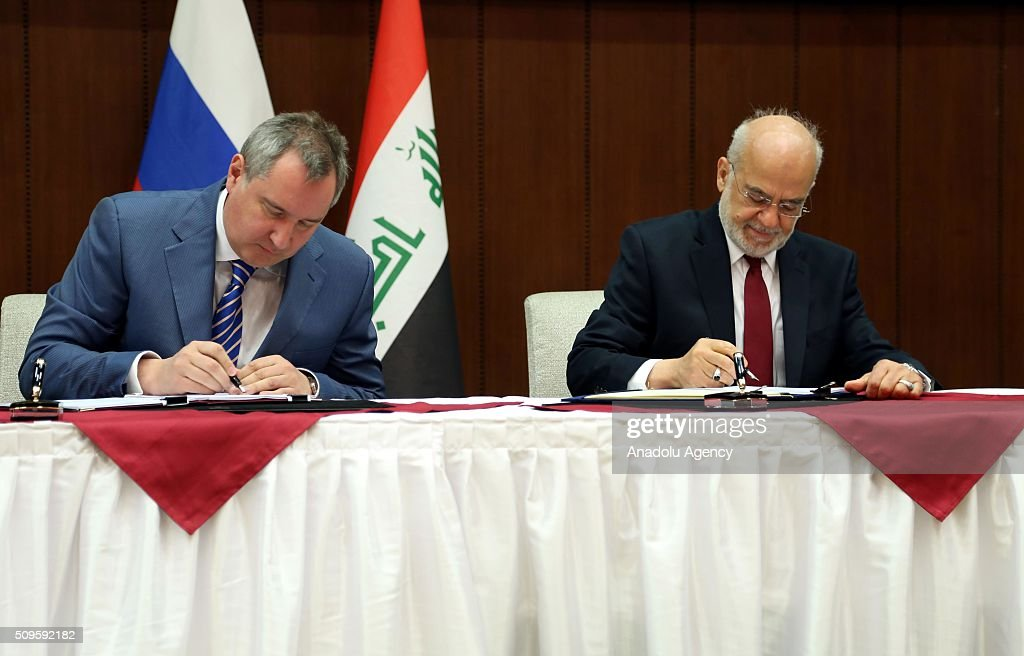Russian Deputy Prime Minister Dmitry Rogozin (L) and Iraqi Foreign Minister Ibrahim al-Jaafari (R) sign protocols on cooperation at the Foreign Ministry in Baghdad, Iraq on February 11, 2016.