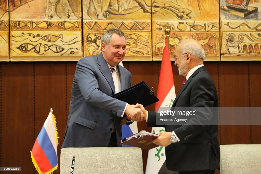 Russian Deputy Prime Minister Dmitry Rogozin (L) and Iraqi Foreign Minister Ibrahim al-Jaafari (R) shake hands after they signed protocols on cooperation at the Foreign Ministry in Baghdad, Iraq on February 11, 2016.