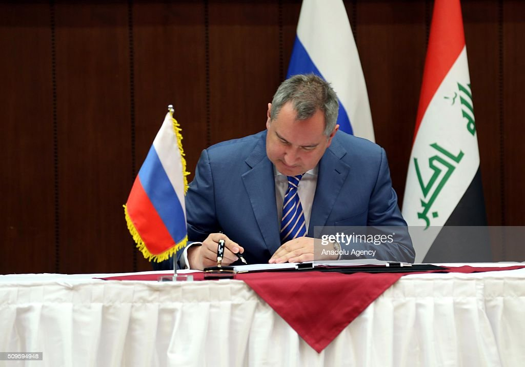 Russian Deputy Prime Minister Dmitry Rogozin signs protocols on cooperation with Iraqi Foreign Minister Ibrahim al-Jaafari (not seen) at the Foreign Ministry in Baghdad, Iraq on February 11, 2016.