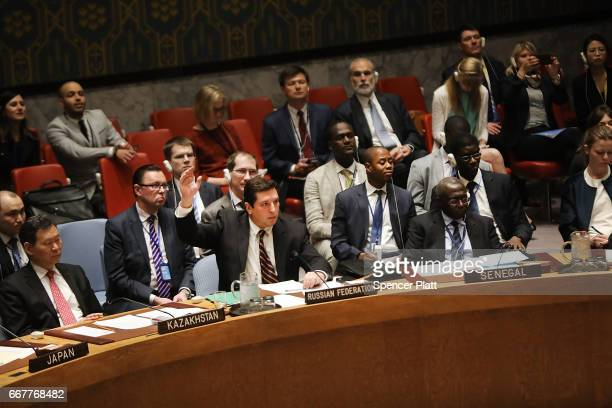 Russian deputy United Nations ambassador Vladimir Safronkov is the sole vote against a vote on a draft resolution demanding that the Syrian...