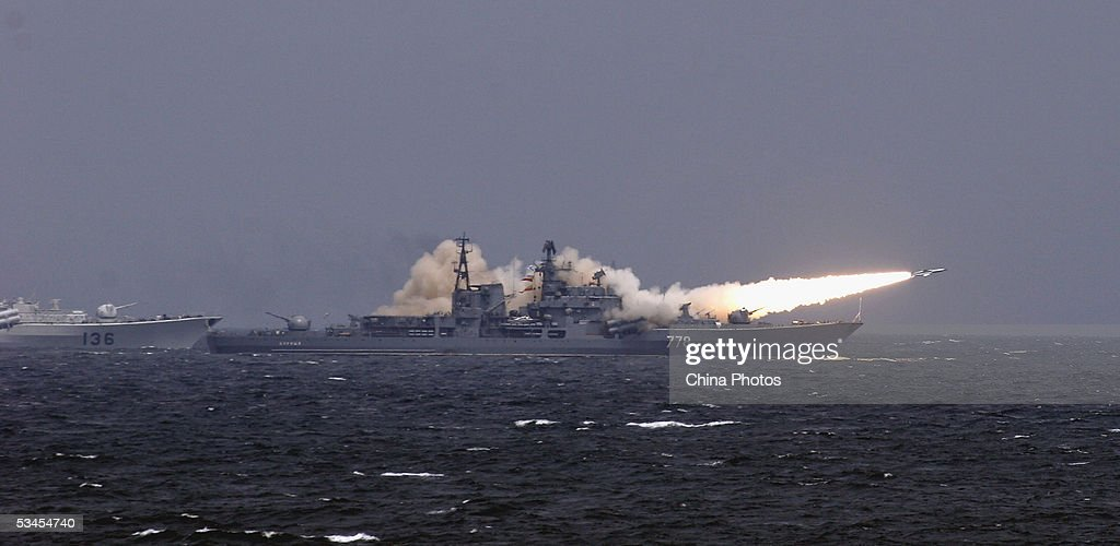 A Russian destroyer launches a shiptoship missile in an offshore blockade exercise during the third phase of the SinoRussian 'Peace Mission 2005'...
