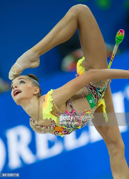 Russian Dina Averina performs the clubs exercise during the FIG 35th Rhytmic Gymnastic World Championship