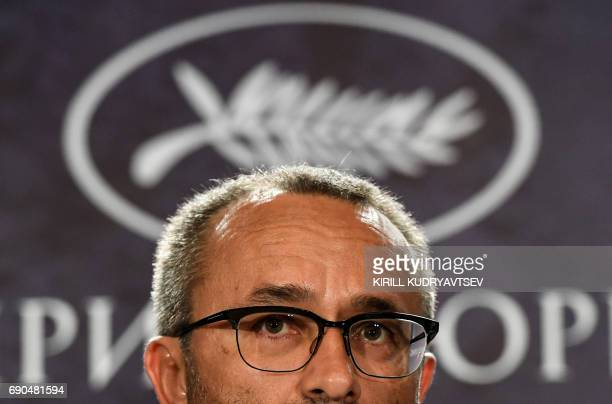 Russian director Andrei Zvyagintsev winner of the Jury Prize for the film 'Loveless' at the 70th edition of the Cannes Film Festival looks on during...