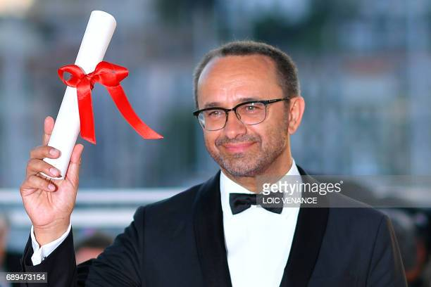 Russian director Andrey Zvyagintsev poses on May 28 2017 during a photocall after he won the Jury Prize for his film 'Loveless' at the 70th edition...