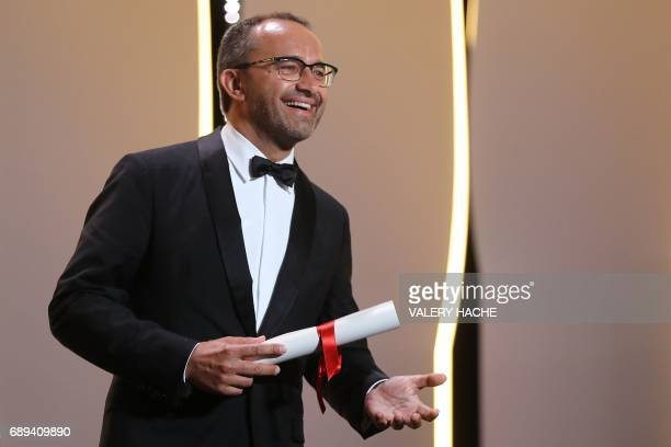 Russian director Andrey Zvyagintsev smiles on stage after he was awarded with the Jury Prize for the film 'Loveless' on May 28 2017 during the...