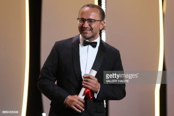 Russian director Andrey Zvyagintsev smiles on stage after he won the Jury Prize for his film 'Loveless' on May 28 2017 during the closing ceremony of...