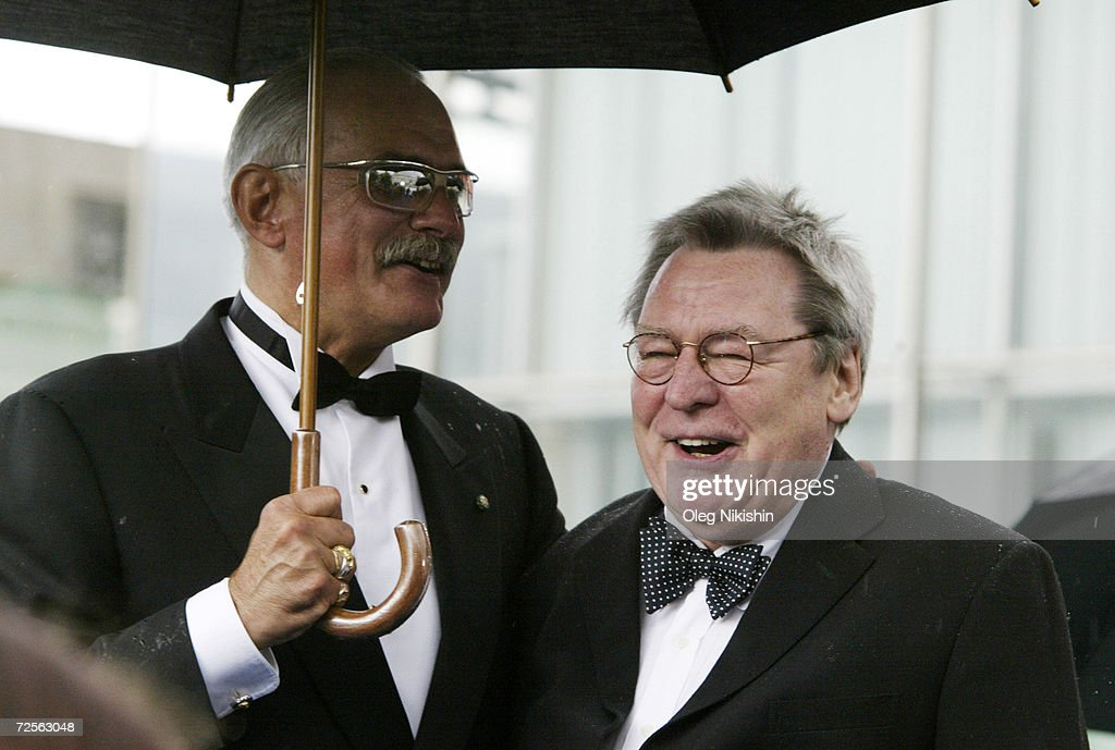Russian director Nikita Mikhalkov and British director and jury president Alan Parker pose for a picture during the opening ceremony of the XXVI...