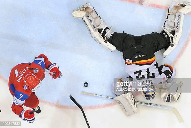 Russian Dmitri Kalinin celebrates scoring against German goalkeeper Robert Zepp during the IIHF Ice Hockey World Championship semifinal match Russia...